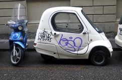 Parked a small car and a scooter royalty free stock photos