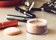 Compact pocket powder and a puff and other cosmetics Stock Photos
