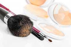 Compact powder and black brush Royalty Free Stock Photos