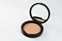 Compact powder for the face, in a black round box with mirror. Royalty Free Stock Images