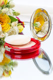 Compact powder and flower Royalty Free Stock Photo
