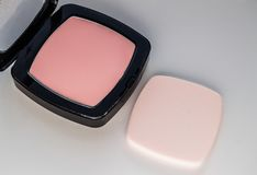Compact powder with puff for makeup, on white background, top view Royalty Free Stock Photos