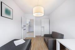 Compact, sleeping room for rental stock image