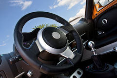 Compact sportscar interior. With steering wheel and gear stick Stock Image