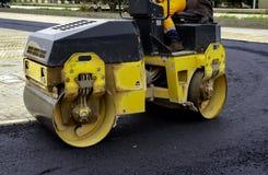 Compact steamroller flatten. Out the asphalt stock photos