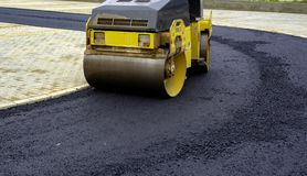 Compact steamroller flatten. Out the asphalt royalty free stock photo