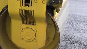 Compact steamroller flatten out the asphalt. stock footage