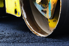 Compact steamroller flatten out the asphalt. At construction area royalty free stock image