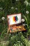 Compact vintage painter's case on grass Stock Photo