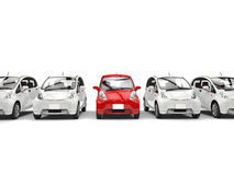 Compact white electric cars in a row - red stands out Stock Images