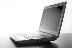 Compact white laptop silhouette on white background. Compact white laptop silhouette on white background Stock Images
