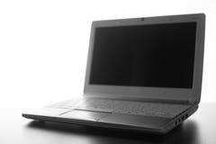 Compact white laptop silhouette on white background. Compact white laptop silhouette on white background Stock Photo