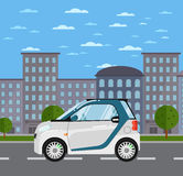 Compact white smart car on road in city Royalty Free Stock Photos
