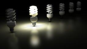 Compacte fluorescente lampen in een rij Stock Foto's