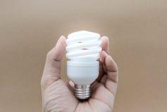 Compacte Fluorescente Lampen met verlichting stock foto