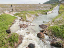 Compacted concrete dam in Thailand. Water flows down from the dam Stock Photo