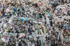 Compacted recyclable plastic. At a recycling plant Royalty Free Stock Images