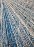 Compacted snow on the road. Compacted to a solid state and ice snow on the road, winter close-up photo Royalty Free Stock Photos