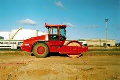 Compacteur rouge Photos libres de droits