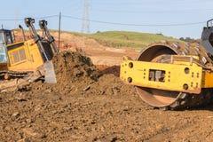 Compactor движенца Earthworks подвергает крупный план механической обработке Стоковые Фотографии RF