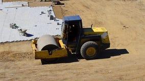 Compactor ролика на месте строительства дорог акции видеоматериалы