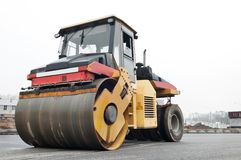 Compactor at asphalt pavement works Royalty Free Stock Photo