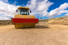 Compactor in compaction works of the earth for later asphalting royalty free stock photo