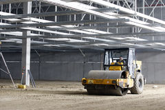 Compactor inside industrial building in progress Royalty Free Stock Images