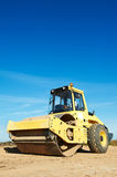 Compactor at road compaction works Stock Photo