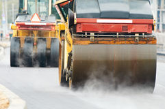 Compactor roller at asphalting work Stock Photo