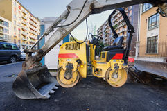 Compactor roller in road in asphalting work Stock Photo