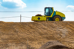 Compactor working on the construction site Stock Images