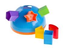 Compaginador de la dimensión de una variable del juguete de Childs en un fondo Fotografía de archivo libre de regalías