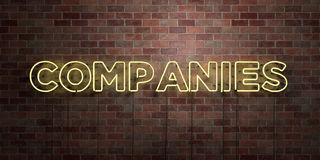 COMPANIES - fluorescent Neon tube Sign on brickwork - Front view - 3D rendered royalty free stock picture. Can be used for online banner ads and direct mailers Royalty Free Stock Photo