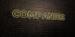 COMPANIES -Realistic Neon Sign on Brick Wall background - 3D rendered royalty free stock image. Can be used for online banner ads and direct mailers Royalty Free Stock Photos