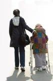 Companion. Senior companion taking their client for a walk white background Royalty Free Stock Photos