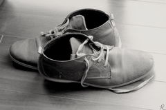The companion. Old shoes after a long walk Royalty Free Stock Image
