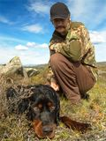 Companions. A hunter and his Gordonsetter Stock Photography
