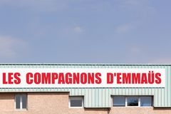 Companions Emmaus sign on a wall. Sassenage, France - June 24, 2017: Companions Emmaus sign on a wall. Emmaus is an international solidarity movement founded in Stock Photo