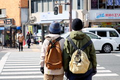 Companions at the zebra crossing on the street of Kyoto, Japan. The photo was taken on the street of Kyoto, Japan Stock Image