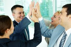 Companionship. Portrait of business group keeping hands close to each other meaning support stock photography