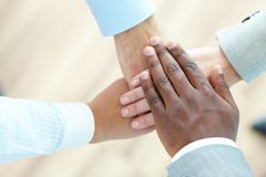Companionship. The above view of a business team piling hands as a sign of companionship Stock Photography