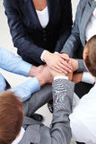 Companionship. Image of business people hands on top of each other stock photography