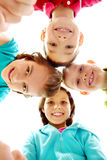 Company. Of four joyful children looking at camera Stock Photo