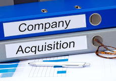 Company and Acquisition, two binders in the office. Company and Acquisition, two binders with text on desk in the office royalty free stock photos