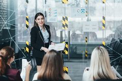 Company advanced training courses business coach. Company advanced training courses. Business coach explaining growth rate charts and graphs issues stock image