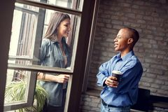 Company manager chat with employee on break for working. Company Afro-American manager chat with female employee on break for working stock photography