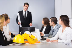 Company of architects brainstorming in office Stock Photos