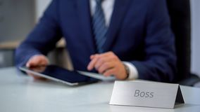 Company boss working on tablet pc, businessman reading business news online royalty free stock images