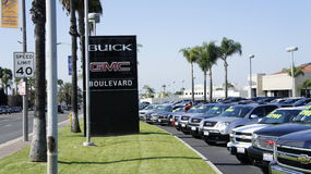 The Company. Of Buick GMC Boulevard displays the brand new and used cars in front of the building Royalty Free Stock Images